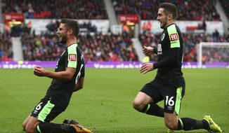 AFC Bournemouth's Andrew Surman, left, celebrates scoring his side's first goal with team-mate Lewis Cook during the English Premier League soccer match between Stoke City and AFC Bournemouth at the Bet365London Stadium, Stoke, England. Saturday Oct. 21, 2017. (Dave Thompson/PA via AP)