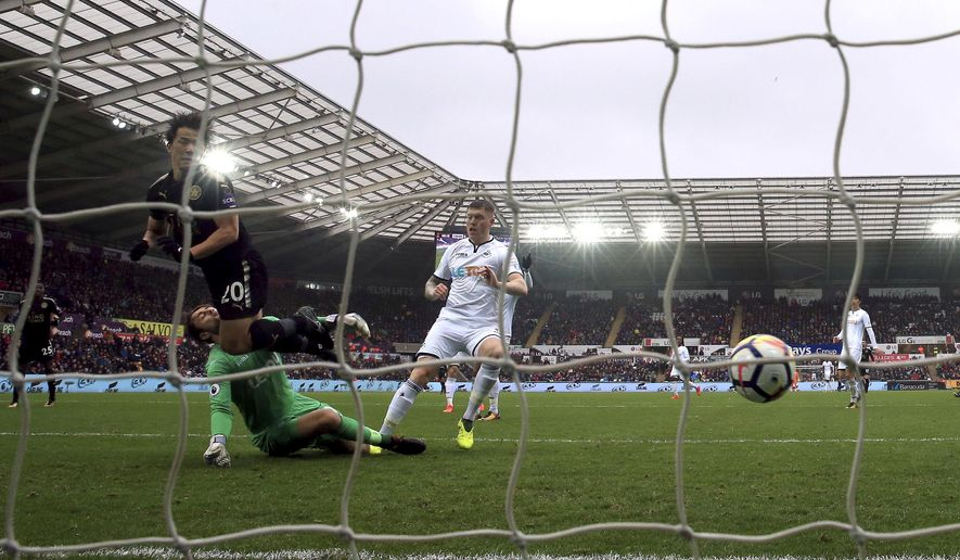 Leicester City's Shinji Okazaki scores his side's second goal of the game, during the English Premier League soccer match between Swansea City and Leicester City at the Liberty Stadium, in Swansea, Wales, Saturday, Oct. 21, 2017. (Nick Potts/PA via AP)