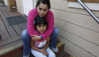 Wilma Illanes and her daughter Gabriela Cervantes, 8, pose Wednesday, Oct. 18, 2017, in Sonoma, Calif. Illanes and her family had to evacuate from there home as a massive wildfire swept through the area last week. While their home was sparred, Illanes, who is a baby sitter, and her husband, who is a landscaper, were both out of work for a work causing them to seek assistance due to the hardship.  AP Photo/Rich Pedroncelli)