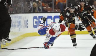 Montreal Canadiens left wing Artturi Lehkonen, left, of Finland, reaches for the puck while under pressure from Anaheim Ducks right wing Corey Perry during the first period of an NHL hockey game, Friday, Oct. 20, 2017, in Anaheim, Calif. (AP Photo/Mark J. Terrill)