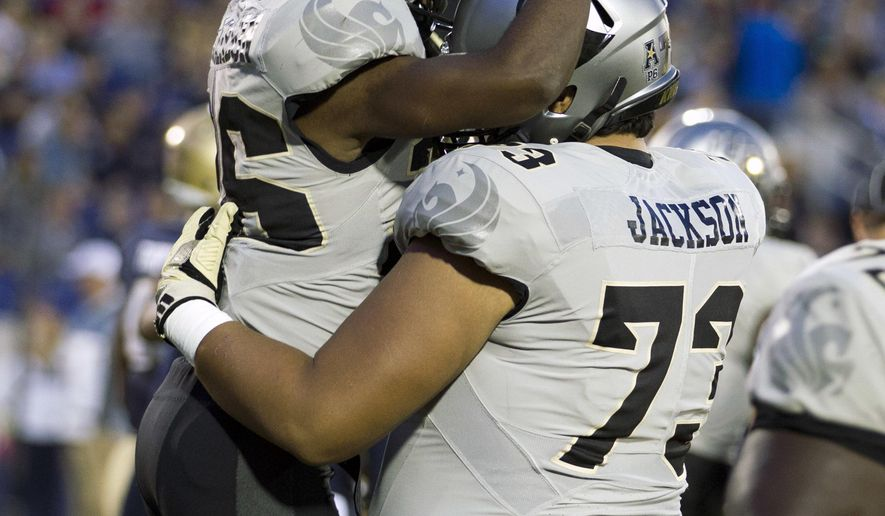Central Florida wide receiver Otis Anderson (26) celebrates with his teammate after scoring a touchdown during the first half of an NCAA college football game against Navy in Annapolis, Md., Saturday, Oct. 21, 2017. (AP Photo/Jose Luis Magana)