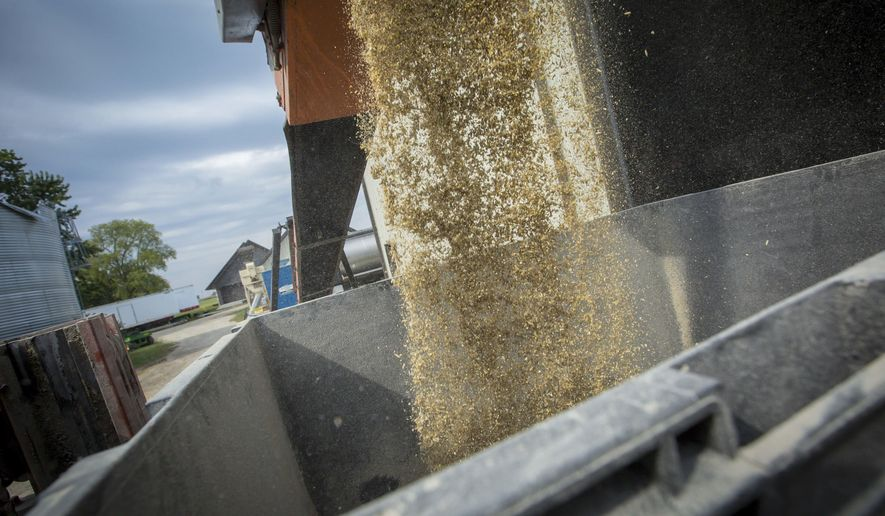 ADVANCE FOR RELEASE SATURDAY, OCTOBER 21, 2017 Mixed horse livestock feed is put in a hopper at the Canfield farm near Dunkerton farm, Monday, Oct. 2, 2017. (Rodney White/The Des Moines Register via AP)
