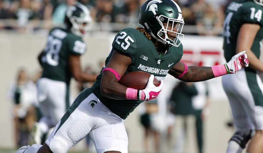 Michigan State's Darrell Stewart rushes against Indiana during the first quarter of an NCAA college football game, Saturday, Oct. 21, 2017, in East Lansing, Mich. (AP Photo/Al Goldis)