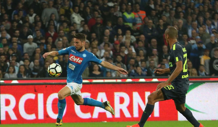 Napoli's Dries Mertens runs past Inter's Miranda during the Italian Serie A soccer match between Napoli and Internazionale of Milan at the San Paolo stadium in Naples, Italy, Saturday, Oct. 21 2017. (Cesare Abbate/ANSA via AP)