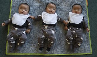 From left, Liam, Lawrence and Logan David are photographed at their Mendenhall Valley home in Juneau, Alaska, Oct. 10, 2017. They are identical triplets born on April 23, 2017, to parents John David and Lory Rowe. (Michael Penn/Juneau Empire via AP)