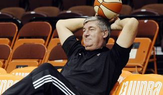 FILE - In this Aug. 29, 2015, file photo, New York Liberty head coach Bill Laimbeer sits on the sideline before a WNBA basketball game against the Connecticut Sun in Uncasville, Conn. Laimbeer found himself at a crossroad. After a discussion with his wife, he decided to head to Las Vegas and lead the relocated WNBA franchise as its president and coach. (AP Photo/Jessica Hill, FIle)