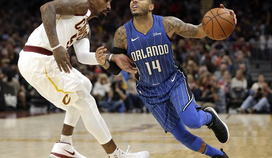 Orlando Magic's D.J. Augustin drives past Cleveland Cavaliers' JR Smith in the second half of an NBA basketball game, Saturday, Oct. 21, 2017, in Cleveland. (AP Photo/Tony Dejak)