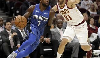 Orlando Magic's Shelvin Mack (7) drives past Cleveland Cavaliers' Jose Calderon (81), from Spain, in the second half of an NBA basketball game, Saturday, Oct. 21, 2017, in Cleveland. (AP Photo/Tony Dejak)