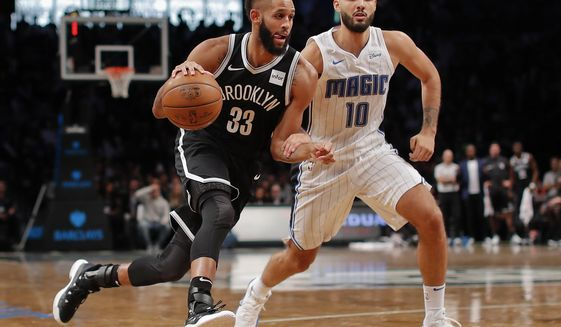 Brooklyn Nets guard Allen Crabbe (33) drives to the basket against Orlando Magic guard Evan Fournier (10) during the fourth quarter of an NBA basketball game, Friday, Oct. 20, 2017, in New York. The Nets won 126-121. (AP Photo/Julie Jacobson)