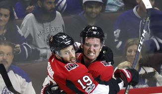 Ottawa Senators centre Derick Brassard (19) celebrates his goal with teammate right wing Mark Stone (61) during second period NHL hockey action against the Toronto Maple Leafs in Ottawa on Saturday, Oct. 21, 2017. (Fred Chartrand/The Canadian Press via AP)
