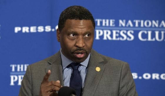 In this Aug. 29, 2017, file photo, Derrick Johnson speaks at a National Press Club (NPC) in Washington. The NAACP has decided to hire its interim leader, Derrick Johnson, as its 19th president and CEO. The board of directors of the nation's oldest civil rights organization made the decision on Saturday, Oct. 21, 2017. (AP Photo/Susan Walsh, File)