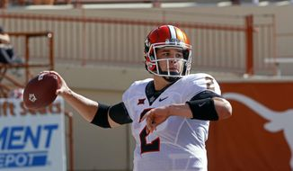 Oklahoma State quarterback Mason Rudolph looks to throw during the first half of an NCAA college football game against Texas, Saturday, Oct. 21, 2017, in Austin, Texas. (AP Photo/Michael Thomas)