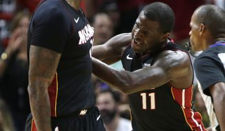 Miami Heat's Dion Waiters (11) reacts after James Johnson, left, scored during the first half of an NBA basketball game against the Indiana Pacers, Saturday, Oct. 21, 2017, in Miami. (AP Photo/Lynne Sladky)
