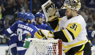 Pittsburgh Penguins goalie Antti Niemi (31), of Finland, reacts after Tampa Bay Lightning right wing Nikita Kucherov (86), of Russia, scored against him during the second period of an NHL hockey game Saturday, Oct. 21, 2017, in Tampa, Fla. (AP Photo/Chris O'Meara)