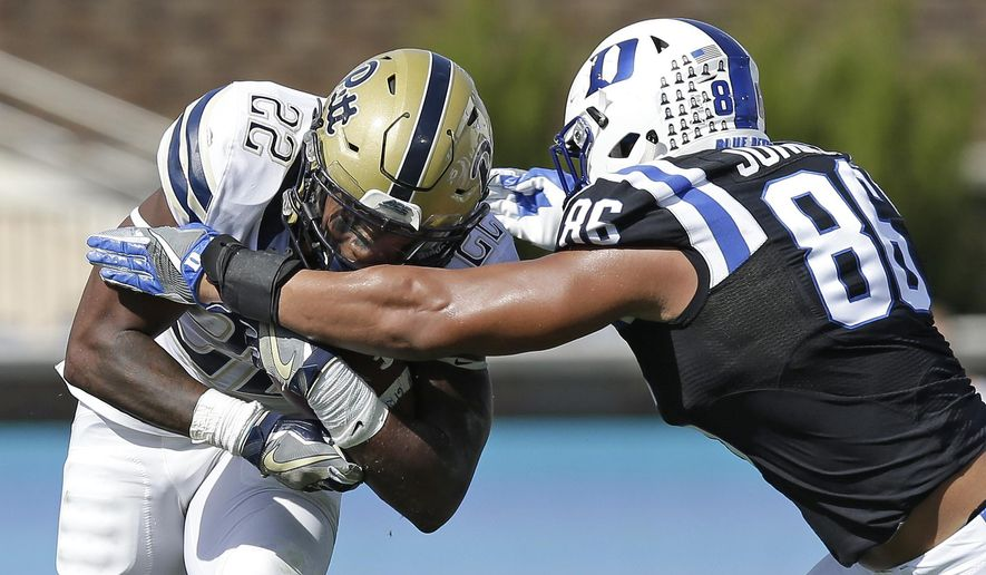 Duke's Drew Jordan (86) reaches for Pittsburgh's Darrin Hall (22) during the first half of an NCAA college football game in Durham, N.C., Saturday, Oct. 21, 2017. (AP Photo/Gerry Broome)