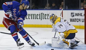 Nashville Predators goalie Juuse Saros stops a shot by New York Rangers' Chris Kreider (20) in the second period of an NHL hockey game, Saturday, Oct. 21, 2017, in New York. (AP Photo/Adam Hunger)