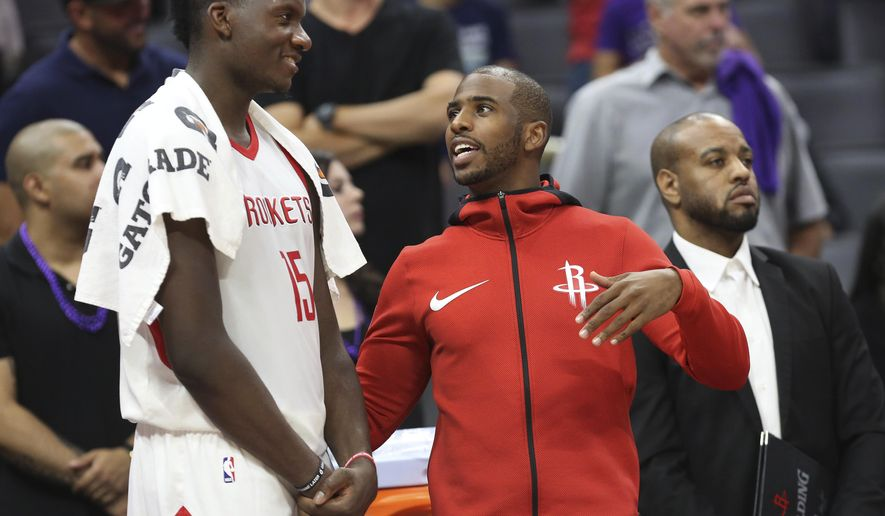 Houston Rockets center Clint Capela (15) and guard Chris Paul talk on the sideline during the second half of an NBA basketball game against the Sacramento Kings in Sacramento, Calif., Wednesday, Oct. 18, 2017. The Rockets won 105-100. (AP Photo/Steve Yeater)