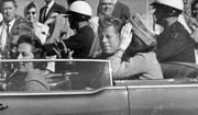 In this Nov. 22, 1963 file photo, President John F. Kennedy waves from his car in a motorcade in Dallas. Riding with Kennedy are First Lady Jacqueline Kennedy, right, Nellie Connally, second from left, and her husband, Texas Gov. John Connally, far left.  President Donald Trump, on Saturday, Oct. 21, 2017,  says he plans to release thousands of never-seen government documents related to President John F. Kennedy's assassination.  (AP Photo/Jim Altgens, File)