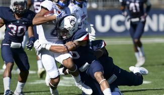 Tulsa wide receiver Keenen Johnson (8) is stopped by Connecticut defensive back Brayden Brown (36) during the first half of the NCAA college football game, Saturday, Oct. 21, 2017, in East Hartford, Conn. (AP Photo/Stephen Dunn)