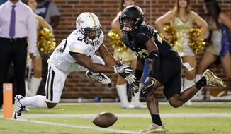 Georgia Tech's Lawrence Austin, left, defends a pass intended for Wake Forest's Greg Dortch but is called for pass interference on the play in the first quarter of an NCAA college football game in Atlanta, Saturday, Oct. 21, 2017. (AP Photo/David Goldman)