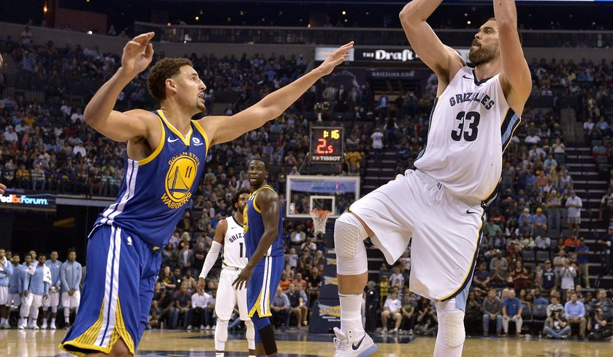 Memphis Grizzlies center Marc Gasol (33) shoots against Golden State Warriors guard Klay Thompson (11) during the second half of an NBA basketball game Saturday, Oct. 21, 2017, in Memphis, Tenn. (AP Photo/Brandon Dill)