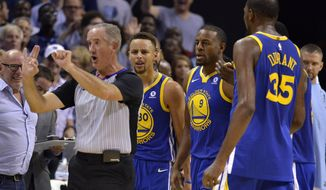 Referee Scott Wall, left, calls Golden State Warriors guard Stephen Curry (30) for a foul as Curry and Warriors forwards Andre Iguodala (9), and Kevin Durant (35) react during the second half of an NBA basketball game Saturday, Oct. 21, 2017, in Memphis, Tenn. Curry and Durant were ejected after arguing with Wall over the call. (AP Photo/Brandon Dill)