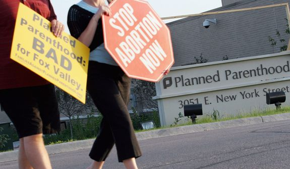 Pro-life Americans might be surprised to learn that abortion providers' access to federal assistance goes beyond collecting money from Medicaid or other health care programs, and even touches the tax code. (Associated Press/File)