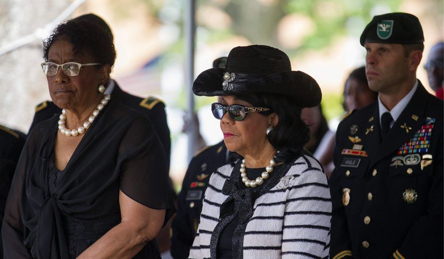 Rep. Frederica Wilson, Florida Democrat (center), attends the burial service of Sgt. La David Johnson in Hollywood, Florida, on Saturday. Mrs. Wilson criticized President Trump's phone call to the slain soldier's widow, which deepened their feud. (Associated Press photographs)