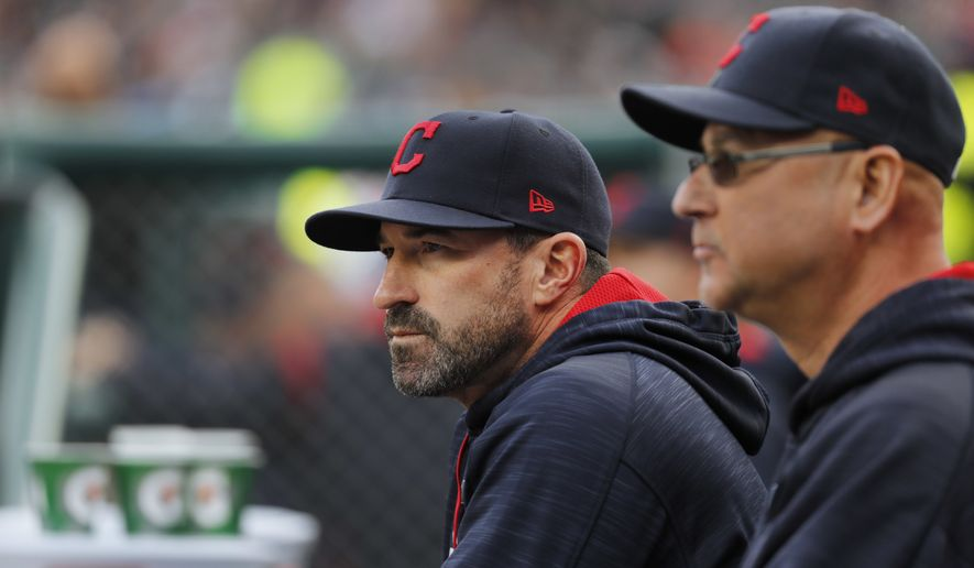 Cleveland Indians pitching coach Mickey Callaway watches with manager Terry Francona against the Detroit Tigers in the first inning of a baseball game in Detroit, Wednesday, May 3, 2017. (AP Photo/Paul Sancya) **FILE**