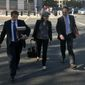 Andrew Weissmann (right) and Kyle Freeny (center) are members of special counsel Robert Mueller's team of prosecutors investigating potential ties between Russia and Donald Trump's 2016 presidential campaign. Mr. Weissmann has made it clear several times that he is not on the president's side. (Associated Press/File)