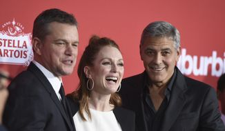 "Matt Damon, from left, Julianne Moore and George Clooney arrive at the LA Premiere of ""Suburbicon"" at the Regency Village Theatre on Sunday, Oct. 22, 2017, in Los Angeles. (Photo by Jordan Strauss/Invision/AP)"