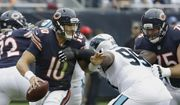 Chicago Bears quarterback Mitchell Trubisky (10) is pressured by Carolina Panthers defensive tackle Kawann Short (99) during the second half of an NFL football game, Sunday, Oct. 22, 2017, in Chicago. (AP Photo/Charles Rex Arbogast)