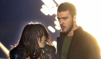 "In this Feb. 1, 2004, file photo, singer Janet Jackson covers her breast as Justin Timberlake holds part of her costume after her outfit came undone during the halftime show of Super Bowl XXXVIII in Houston. The NFL announced Sunday, Oct. 22, 2017, that Timberlake will headline the Super Bowl halftime show Feb. 4 in Minnesota, 14 years after the ""wardrobe malfunction"" with Janet Jackson cause a national controversy. (AP Photo/Elise Amendola, File)"