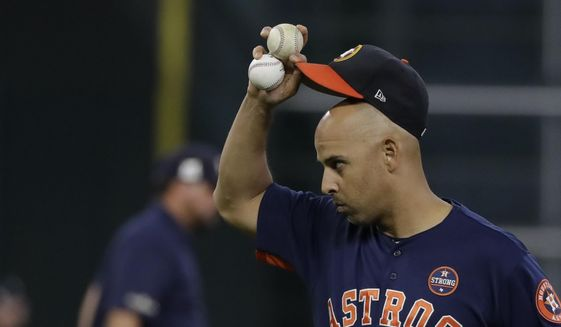 Houston Astros bench coach Alex Cora tips his hat during batting practice before Game 6 of the American League Championship Series baseball game against the New York Yankees Friday, Oct. 20, 2017, in Houston. (AP Photo/David J. Phillip) **FILE**