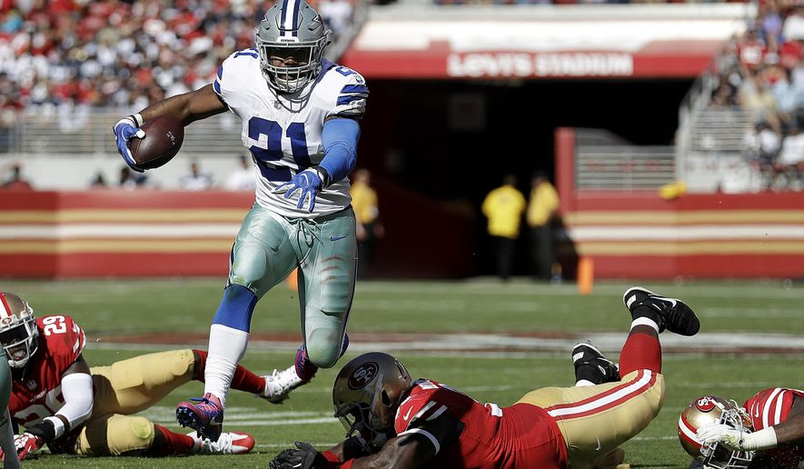 Dallas Cowboys running back Ezekiel Elliott (21) runs against the San Francisco 49ers during the first half of an NFL football game in Santa Clara, Calif., Sunday, Oct. 22, 2017. (AP Photo/Marcio Jose Sanchez)