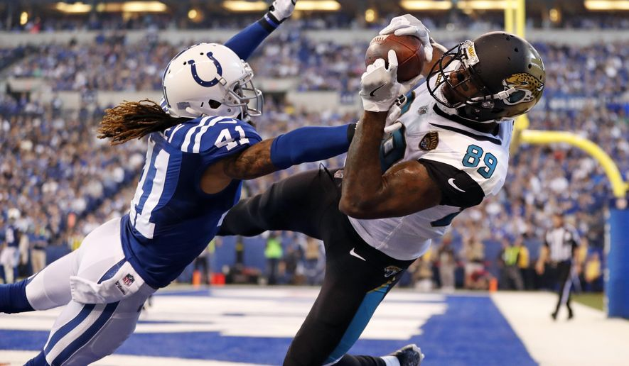Jacksonville Jaguars tight end Marcedes Lewis (89) makes a catch for a touchdown over Indianapolis Colts strong safety Matthias Farley (41) during the first half of an NFL football game in Indianapolis, Sunday, Oct. 22, 2017. (AP Photo/Jeff Roberson)
