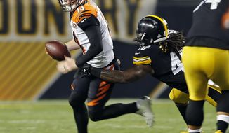 Cincinnati Bengals quarterback Andy Dalton (14) is sacked by Pittsburgh Steelers outside linebacker Bud Dupree (48) during the second half of an NFL football game in Pittsburgh, Sunday, Oct. 22, 2017. (AP Photo/Keith Srakocic)