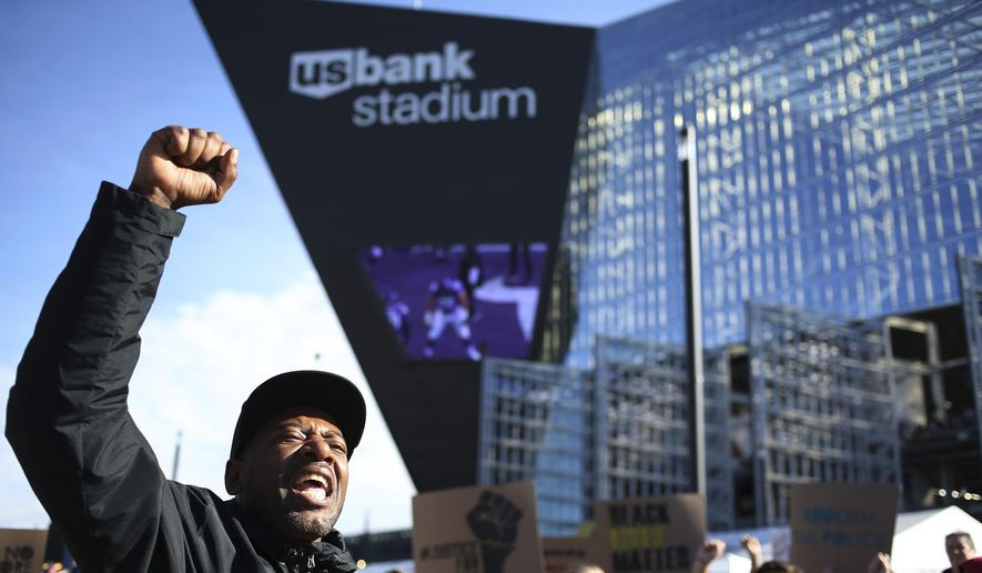 "John Thompson and members of Black Lives Matter protest during a Twin Cites Rally ""Takes a Knee"" against police violence at U.S. Bank Stadium on Sunday, Oct. 22, 2017, in Minneapolis. (Jerry Holt/Star Tribune via AP) ** FILE **"