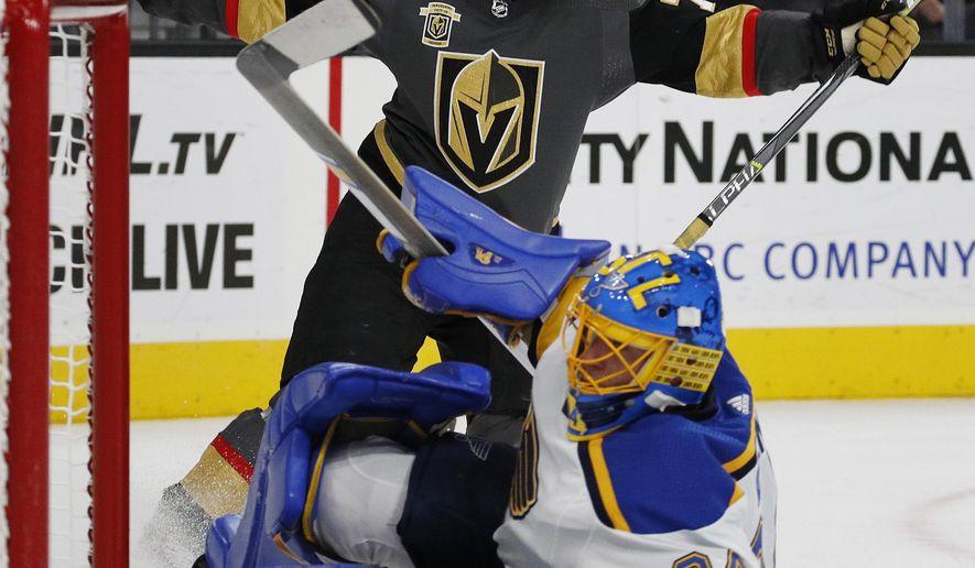 Vegas Golden Knights center William Karlsson celebrates after scoring against St. Louis Blues goalie Jake Allen during overtime of an NHL hockey game Saturday, Oct. 21, 2017, in Las Vegas. The Golden Knights won 3-2. (AP Photo/John Locher)