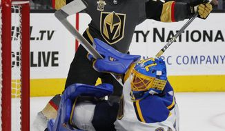 Vegas Golden Knights center William Karlsson celebrates after scoring against St. Louis Blues goalie Jake Allen during overtime of an NHL hockey game Saturday, Oct. 21, 2017, in Las Vegas. The Golden Knights won 3-2. (AP Photo/John Locher)