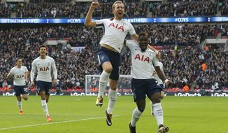 Tottenham's Harry Kane, center, celebrates after scoring his side's first goal during the English Premier League soccer match between Tottenham Hotspur and Liverpool at Wembley Stadium in London, Sunday, Oct. 22, 2017. (AP Photo/Frank Augstein)