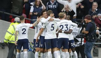 Tottenham's teammates celebrate after scoring their side's fourth goal during the English Premier League soccer match between Tottenham Hotspur and Liverpool at Wembley Stadium in London, Sunday, Oct. 22, 2017. (AP Photo/Frank Augstein)