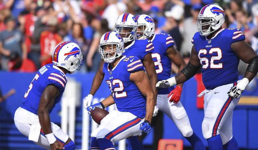 Buffalo Bills tight end Logan Thomas (82) and Tyrod Taylor (5) celebrate with teammates after they connect for a touchdown during the second half of an NFL football game against the Tampa Bay Buccaneers Sunday, Oct. 22, 2017, in Orchard Park, N.Y. (AP Photo/Rich Barnes)