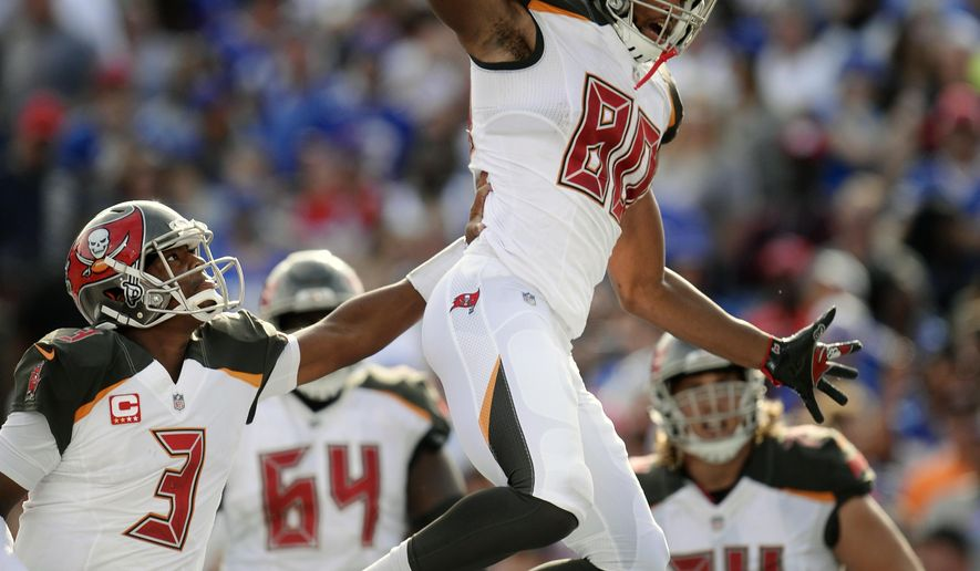 Tampa Bay Buccaneers quarterback Jameis Winston (3) and O.J. Howard (80) celebrate after they connected for a touchdown during the second half of an NFL football game against the Buffalo Bills, Sunday, Oct. 22, 2017, in Orchard Park, N.Y. (AP Photo/Adrian Kraus)