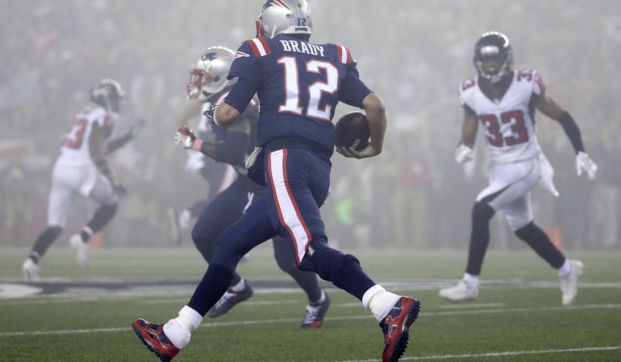 New England Patriots quarterback Tom Brady (12) runs in the fog as Atlanta Falcons defensive back Blidi Wreh-Wilson (33) pursues during the second half of an NFL football game, Sunday, Oct. 22, 2017, in Foxborough, Mass. (AP Photo/Steven Senne)