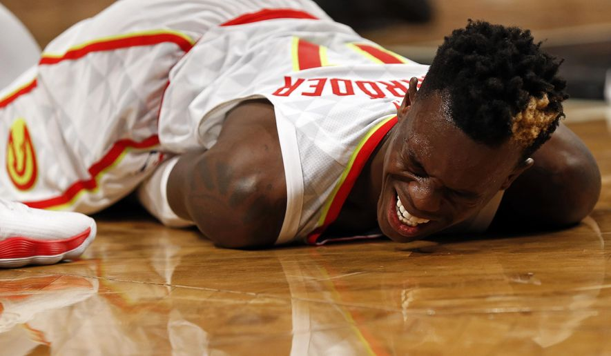 Atlanta Hawks' Dennis Schroder reacts after an injury during the fourth quarter of an NBA basketball game against the Brooklyn Nets, Sunday, Oct. 22, 2017, in New York. (AP Photo/Adam Hunger)