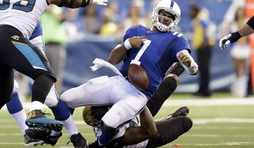 Indianapolis Colts quarterback Jacoby Brissett (7) fumbles as he is sacked by Jacksonville Jaguars defensive end Calais Campbell (93) during the second half of an NFL football game in Indianapolis, Sunday, Oct. 22, 2017. (AP Photo/AJ Mast)