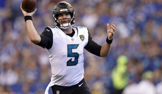 Jacksonville Jaguars quarterback Blake Bortles (5) throws against the Indianapolis Colts during the first half NFL football game in Indianapolis, Sunday, Oct. 22, 2017. (AP Photo/Jeff Roberson)