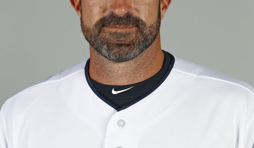 FILE - This Feb. 24, 2017 file photo shows Cleveland Indians pitching coach Mickey Callaway posing for a picture on photo day at the team's baseball spring training facility in Goodyear, Ariz. It appears the New York Mets have settled on their choice for a manager. Several media outlets are reporting the team has offered the job to Callaway. The New York Post was the first to report the Mets were in talks with Callaway, saying a deal is being finalized. When contacted Sunday, Oct. 22, 2017 multiple Mets officials declined to comment. (AP Photo/Ross D. Franklin)
