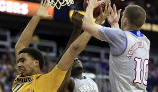 Missouri forward Jontay Porter (11) is stripped of the ball by Kansas center Udoka Azubuike (35) and guard Sviatoslav Mykhailiuk (10) during the second half of an exhibition NCAA college basketball game in Kansas City, Mo., Sunday, Oct. 22, 2017. Kansas defeated Missouri 93-87. (AP Photo/Orlin Wagner)